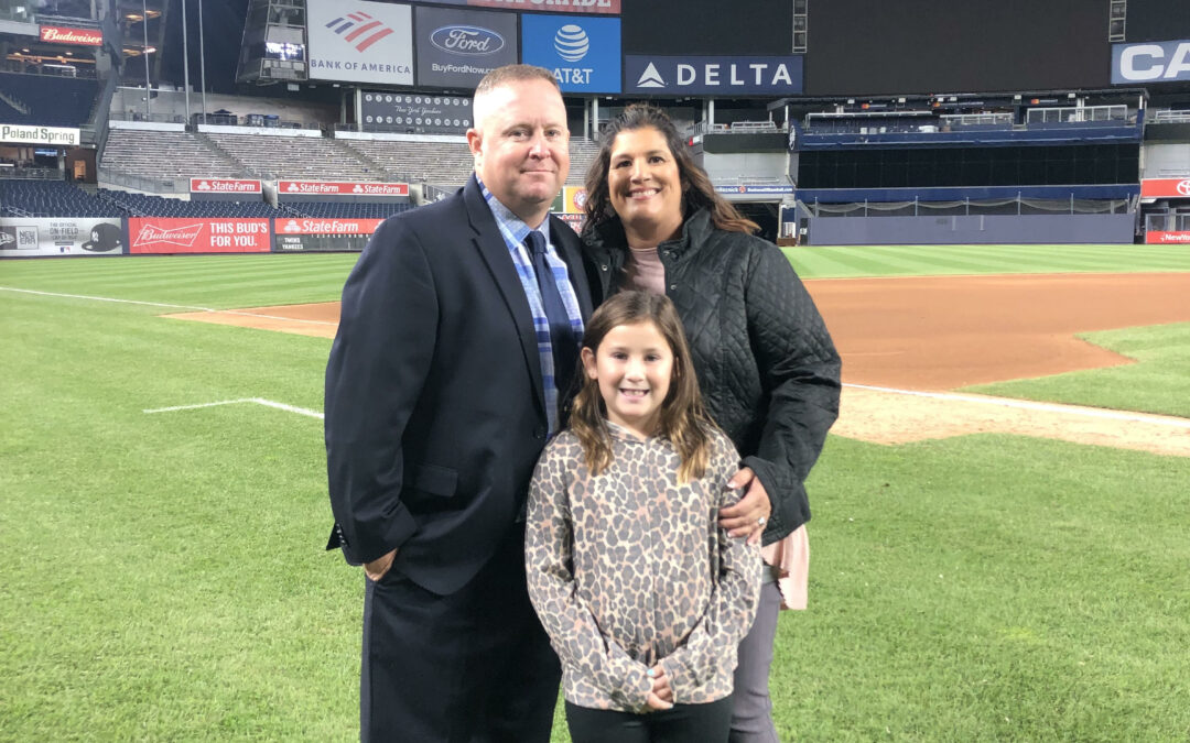 MLB Umpire Todd Tichenor, and his wife, Kelly, and their daughter at Yankee Stadium